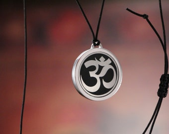 Om mens silver pendant with black enamel and makrame cord
