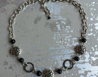 Silver patterned metal and black glass bead necklace