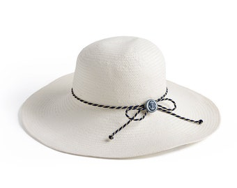 Wide brim hat , Custom hats , White floppy hat decorated with a nautical cord and an anchor button.
