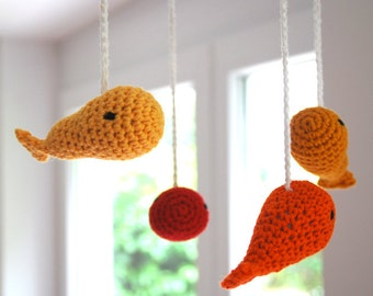 Crochet mobile whales (red/orange/yellow)