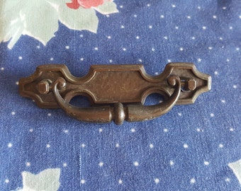 One Brass Swing Handle Drawer Pull with Hammered Background