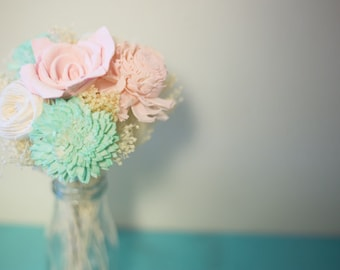 Pink mint and cream sola flower arrangment