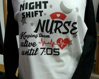 Night Shift Nurse - Keeping them alive until 7:05 - Raglan Sleeve T-Shirt in a variety of colors.