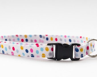 Cat collar handmade using multicoloured spotty fabric, with a breakaway buckle and bell. Kitten collar size option.
