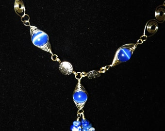Blue cat eye necklace and earrings