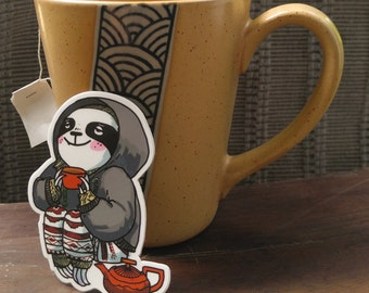 STICKER — Sloth in a sweater with tea