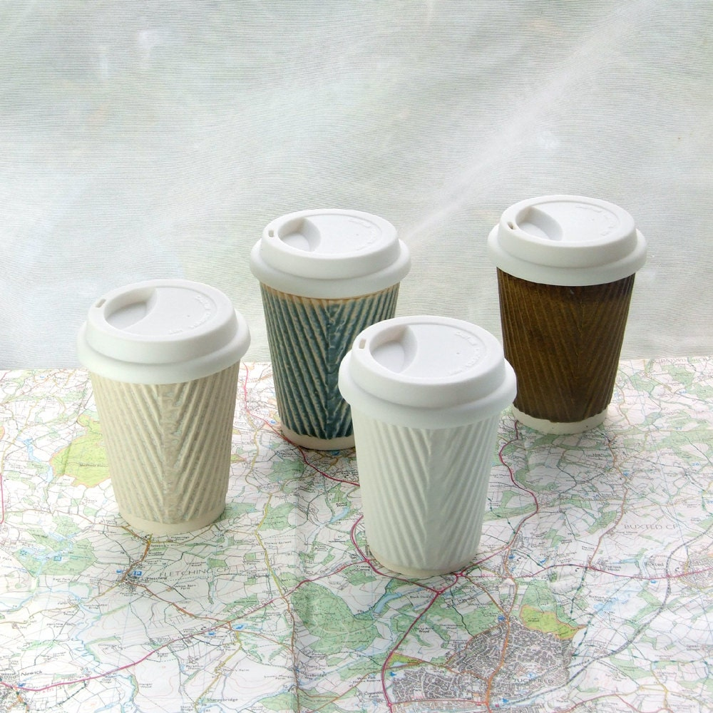 coffee cup or ceramic travel mug with lid by