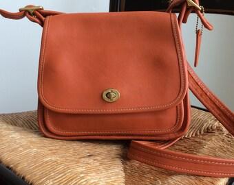 rare vintage orange coach rambler bag