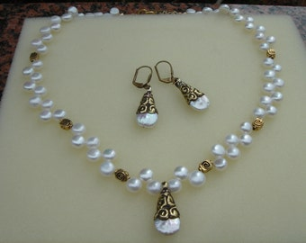 String of pearls, freshwater pearls and brass, antique look gold-plated,