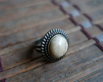 Ring coral agate fossil and bronze metal