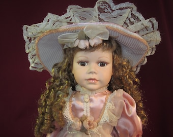 "Emerald Doll Collection ""Diana"" 18"" golden hair porcelain doll with lacey pink dress and hat ,stand,under clothes,brown eyes,shoes,purse,"