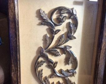 Carved wood in display case