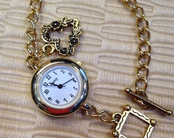 Golden Charm Bracelet Watch