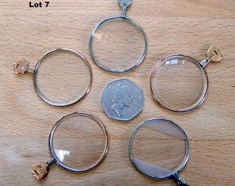 Lot of five quality vintage optical lenses from an optician's testing set
