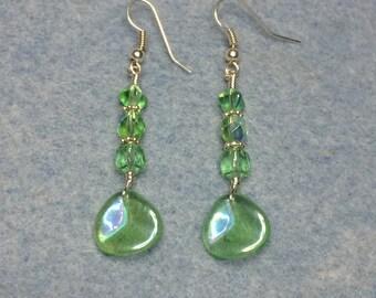 Light green Czech glass rose petal dangle earrings adorned with light green Czech glass beads.