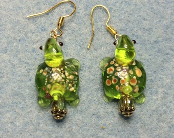 Spotted lime green lampwork turtle bead earrings adorned with lime green Czech glass beads.