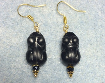 Carved black stone frog bead earrings adorned with black Chinese crystal beads.