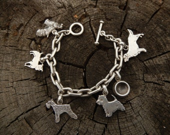 FINE ARF Dog lover's charm bracelet, handmade sterling silver heavy cast bracelet.  7.5 inches United States made Lisa Greene