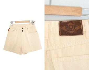 Vintage oatmeal denim jean shorts. 1990s jean shorts. Womens shorts. Beige jean shorts. High waist jean shorts. Pop Jeans. Womens size 7/8.