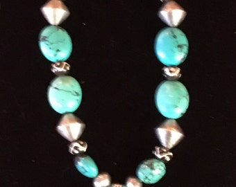 Tibetan turquoise, African beads, sterling.