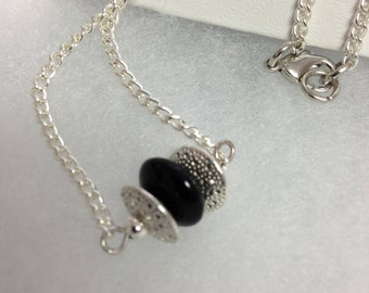 Beautiful black bead weaved pendant with chain...