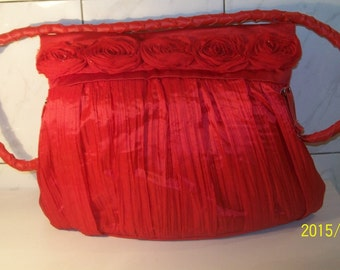 Red handbag pleated shoulder braided, crumpled fabric, red roses