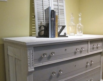 Grey antique dresser in white
