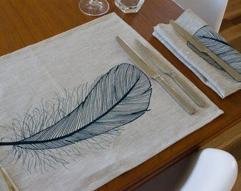 Linen placemat with feather print in dark blue on natural. Set of 4. Screen printed by hand. 100% linen.
