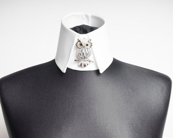 Designer changing the collar Haute Couture collar with OWL as a flower brooch