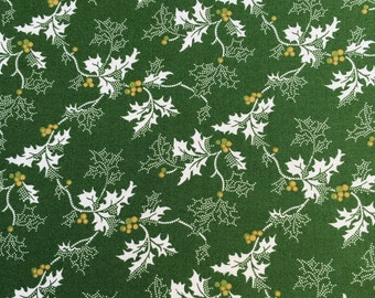 "Windham ""Yuletide"" Holly leaves on green fabric."