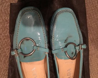 Rewind 102:   Prada. Baby blue, patent leather loafer with silver circle design at Dimitrios Furs
