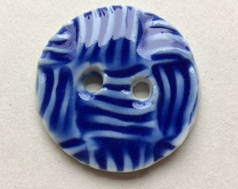 Large, cheerful bright blue textured circular 1.5-inch procelain ceramic button