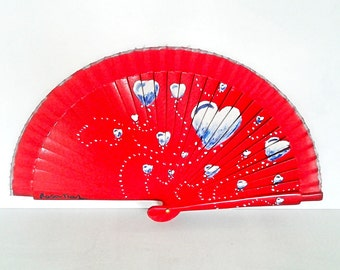 Small red fan with blue and white hearts hand painted