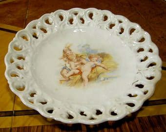 Ribbon plate with cherubs