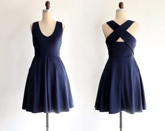 SOLSTICE | Navy - navy blue cross back straps dress. retro halter style bridesmaid dress. back cut out fit and flare dress with pockets