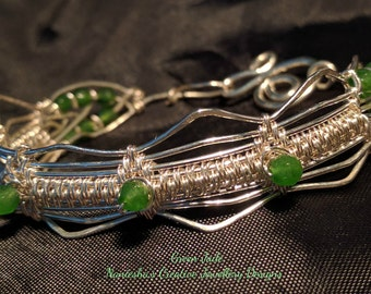 Beautifully, hand woven, bracelet in, fine silver, with, Jade beads.