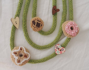NECKLACE-Greedy wool.Tubular knit.3strings.Light green.Added 3 HEART wood buttons-3 Crochet PASTRIES(chocolate tart-2iced donuts).hand made