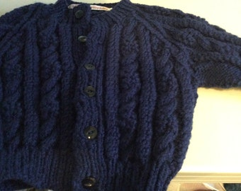 Boys  aran cable knit cardigan age 2-3 years approx length is 14.5 inches made in blue aran wool / gift / handknit