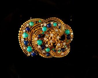 Brooch with 18 ct gold Alpinestars turquoise, lapis lazuli and 1 ct. diamonds.
