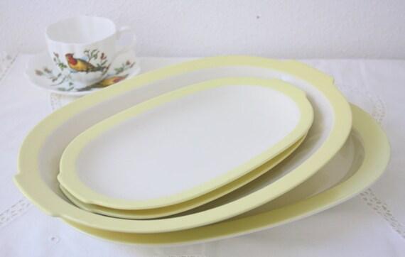 Set of Four Vintage Dutch Petrus Regout Oval Serving Plates, Pastel Yellow Rims, Holland