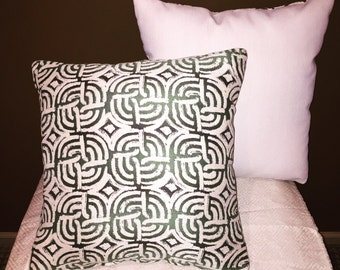 Green and white accent pillows