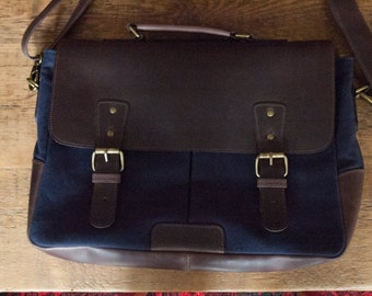 Navy blue canvas and brown leather messenger bag