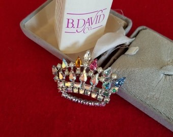 B.David crown brooch with box and pamphlet