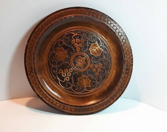 Wooden wall plate, wood turning, grape, flower & leaf design, copper highlights, 8 5/8 inch