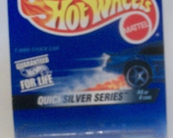 1996 Mattel Hot Wheels Quicksilver Series Blue T-Bird Stocker 4 of 4  Malaysia  1/64 Scale Diecast Vehicle New on Card #548 5 Spoke wheels