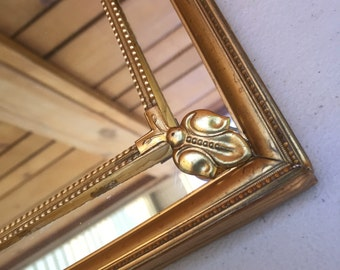 Vintage 10 X 12 wall mirror with ornate brass frame. Hollywood Regency.