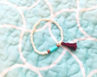 Aqua, White, and Burgundy Tassel Bracelet