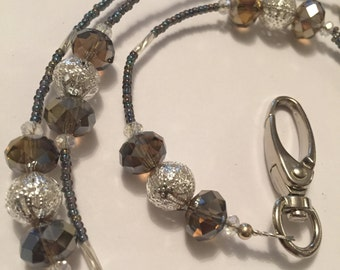 Smokey Purple Crystal Rondelles combined with silver filigree beads and shade of purple seed bead Lanyard