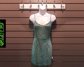 Classic Cut Lace Dress With Adjustable Shoulder Straps in Daisy Blue Floral Lace Design Over BeigeGold Under Garment.