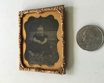 Gem sized tintype , very clear adorable chubby baby, sitting on floor, pretty carpet, timeless treasure.